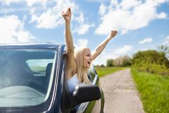 Woman Raising Hand Out Of Car Window Stock Photography