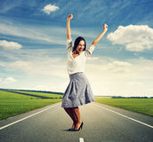 Woman raising hands up and laughing Royalty Free Stock Image