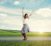 Woman raising hands up and smiling Royalty Free Stock Images