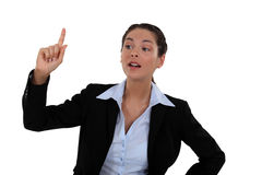 Woman raising her hand. In the air royalty free stock photo