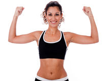 Woman raising her hands doing exercises Stock Image