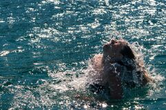 Woman raising her head out of the water