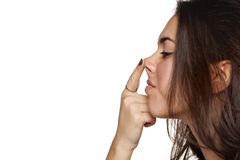 Woman raising her nose. Profile view of a girl raising her nose with her finger Stock Photos