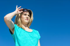Woman raising sunglasses Royalty Free Stock Image