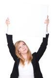 Woman raising white panel. Red-haired woman raising white panel Stock Image