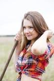 Woman and rake handle adjust long hair Royalty Free Stock Photography