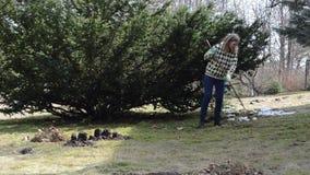 Woman rake leaf molehill stock footage