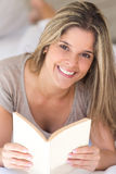Woman ralaxing with a book Royalty Free Stock Images