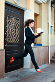 Woman ran out of the office manager and  hurry. Royalty Free Stock Photo