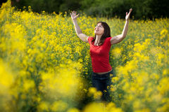 Woman in rape field Stock Photo