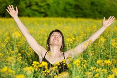 Woman in rape field Stock Photo