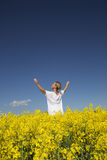 Woman on a Rape Field Stock Photo
