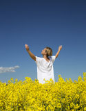 Woman on a Rape Field Stock Images