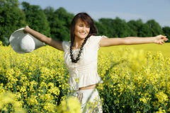 Woman in the rape field Stock Photos