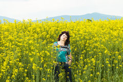 Woman in rape flower Royalty Free Stock Photos
