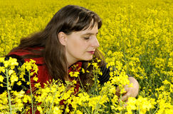 Woman in rapefield Royalty Free Stock Photo