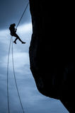 Woman rappeling silhouette Stock Photos