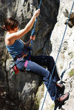 Woman Rappelling Royalty Free Stock Images