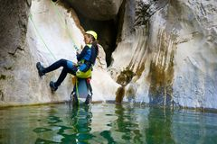 A woman rappelling in Pyrenees, Spain. Stock Image