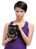 Woman with rarity photographic camera Stock Photo