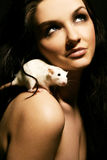 Woman and rat Stock Photos