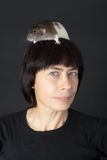 Woman with a rat on her head Royalty Free Stock Photos