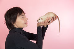Woman and rat Stock Image
