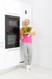 Woman raw fresh vegetables refrigerator. Young woman hold raw fresh vegetables refrigerator, diet healthy organic vitamin food concept, pretty girl smile full Stock Photo