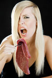 Woman with raw meat royalty free stock photos