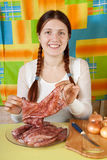 Woman with raw squid in  kitchen Royalty Free Stock Photography