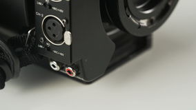 Woman Re-plugging a White Cable to a Video Camera. Cable plugging. Close-up. Shot on RED Epic stock video footage