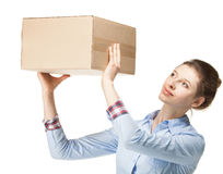 Woman reaches out a cardboard box. Isolated on white Royalty Free Stock Photo