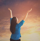 Woman reaches up in praise Stock Image