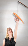 Woman Reaching for Carrot Stick Royalty Free Stock Images