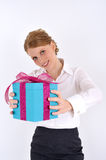 Woman reaching a gift box. Red haired woman holding a gift box. Very Cheerful. Woman is in focus Stock Photography