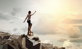Woman reaching hand up Stock Image