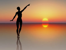 Woman reaching for the sun Royalty Free Stock Photos