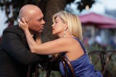 Woman reaching to kiss her man Stock Photo