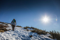 Woman Reaching the Top of Richardson Mountain in National Park o stock photo