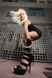 Woman reaching towards the ground Royalty Free Stock Photo
