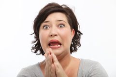 Woman reacting in shock and horror Stock Images
