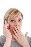 Woman reacting in shock to mobile call Stock Image
