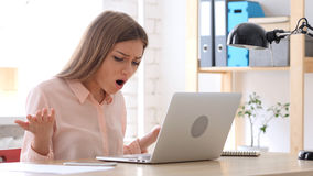 Woman Reacting to Loss, Working on Laptop Royalty Free Stock Photography
