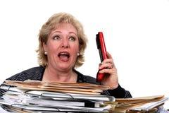 Woman reacts to caller shouting Stock Photos