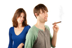 Woman reacts to man with cigar Royalty Free Stock Images