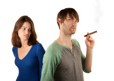 Woman reacts to man with cigar Royalty Free Stock Photography