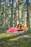 Woman Read Book And Enjoying Outdoor Picnic Stock Photo