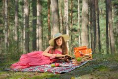 Woman Read Book And Enjoying Outdoor Picnic Royalty Free Stock Photography
