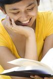 Woman read book with fun royalty free stock photography
