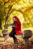 Woman read book in park Stock Photography